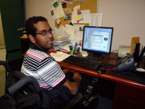 Man using a wheelchair working at desk
