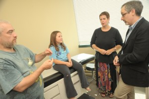Family at doctors office using sign language to communicate